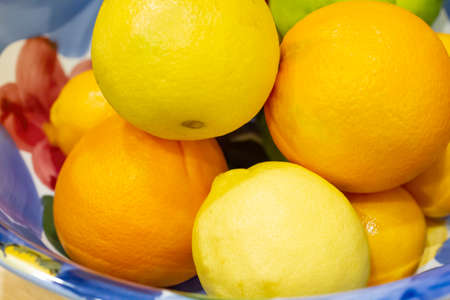 Large bowl of lemons and oranges in a kitchen