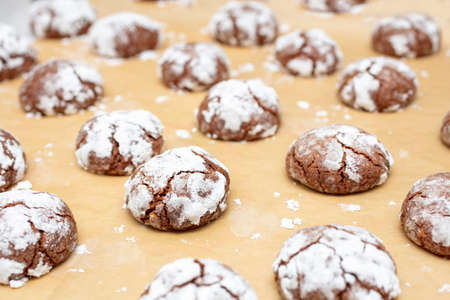 Powdered sugar crackled on Chocolate Crinkle cookies during the holiday season 스톡 콘텐츠