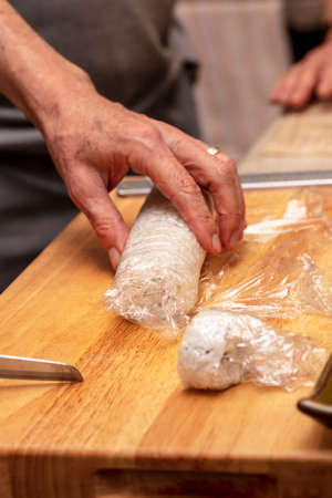 Demonstration class on how to make an outer rice shushi roll with crab meat