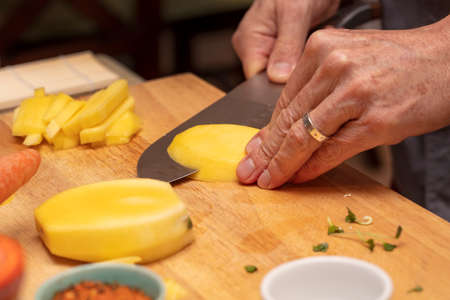 Chef teaching how to cut fruit julienne style for a sushi class