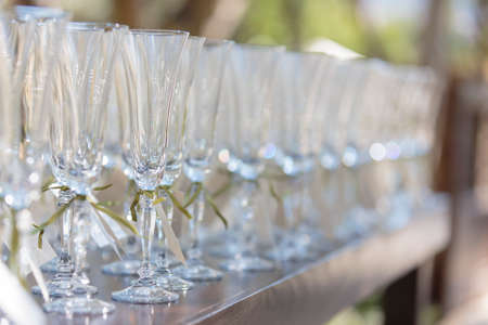 Empty champaigne glasses in rows labeled for a party table during a wedding ceremony Reklamní fotografie