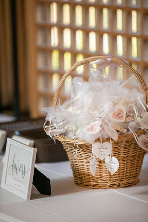 Wrapped and labeled candies with date tags on a ceremonial table for a weeding celebration Reklamní fotografie