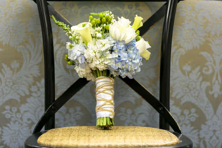 Blue hydrangeas and white flower bouquet on a chair for a wedding ceremony Reklamní fotografie