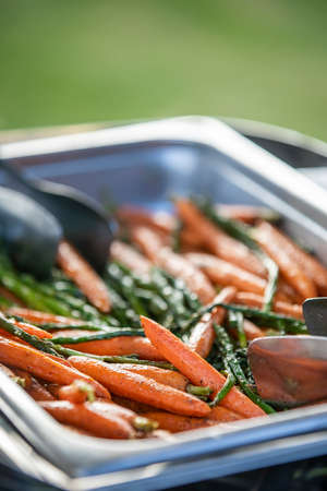Roasted carrots in a catered tray for a ceremony and party Reklamní fotografie