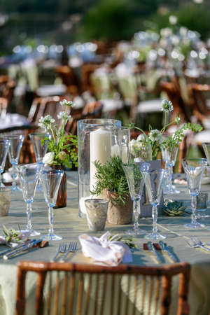 Table setting for a wedding ceremony in  an outdoor patio area