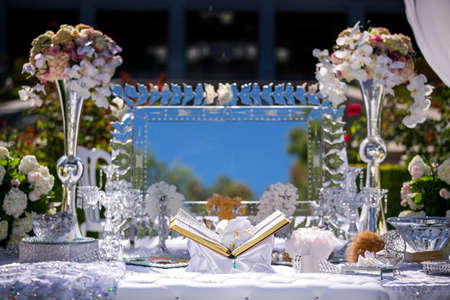 Traditional wedding setting for a Persian ceremony with the Book of Poetry and other decorations Reklamní fotografie