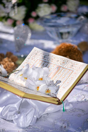 Bood Of Poetry set on a decorated table for a Persian wedding ceremony