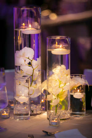 Table decorated for a wedding ceremony with water containers and floating candles Reklamní fotografie