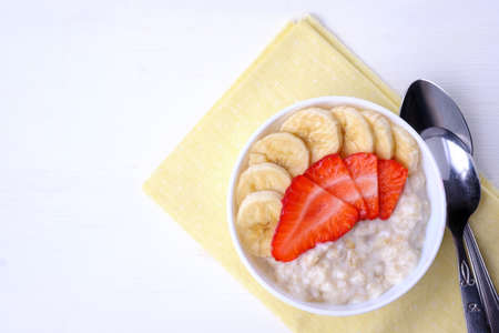 Bowl of breakfast muesli decorated with banana slices and chia seed