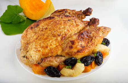 Roast Turkey, chicken, decorated with pumpkins prunes apples