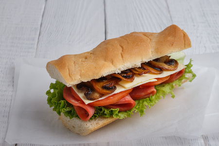 Sandwich with tomato cheese and champignon mushrooms