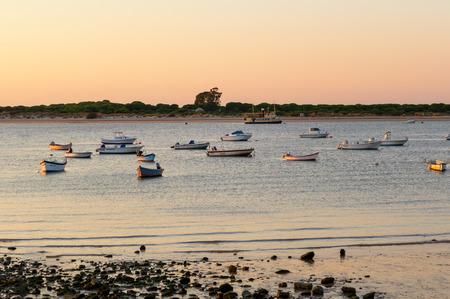 Fishing boats at sunset Redactioneel