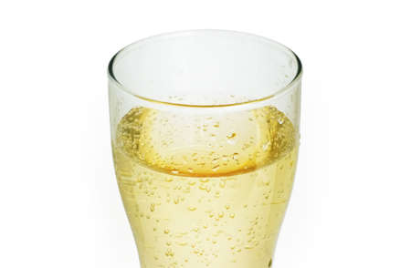 thinness: A glass of apple juice with sparkling water on a white background