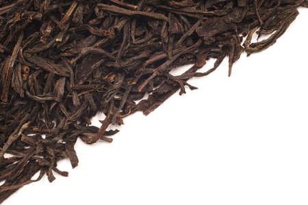 pekoe: Black leaf tea on the half of the frame. Photographed close-up.
