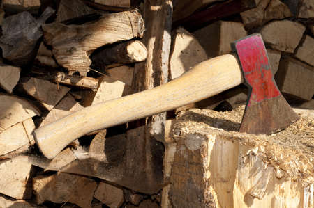 axe and stack of firewood