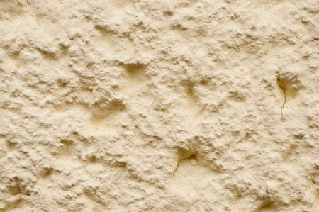 Roughcast on a housewall in Germany, light yellow Stock Photo