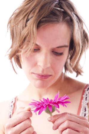 Young woman with flower, close up, isolated, white background Stock Photo