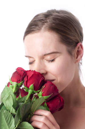 Young woman with red roses, isolated, white background photo