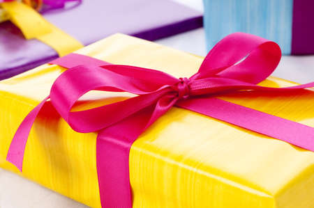 Present boxes in different colors, usable as symbol for christmas, valentine, birthday etc.  Stock Photo - 6979479