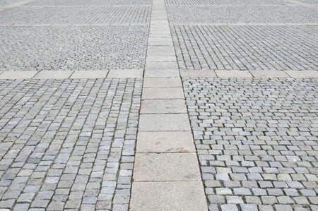 Bestrating van graniet in de stad Berlijn.  Stockfoto