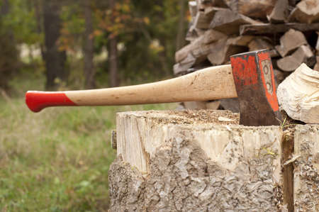 Axe and a stack of firewood Stock Photo