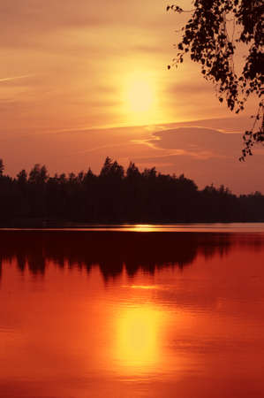 Sunset over a lake in Sweden, Scandinavia Stock Photo