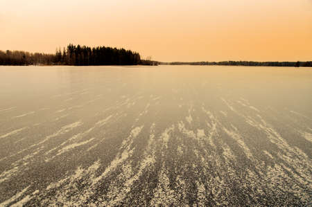 Frozen lake in the swedish countryside in Småland (Sweden).