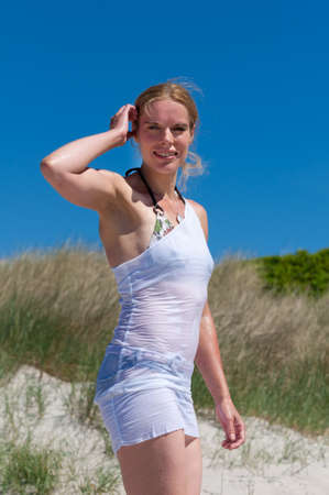 Sensuell portrait of a young woman in a white, wet beach dress Stock Photo - 11545512