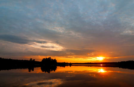 Sunset over a lake in Sweden photo