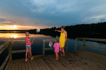Young attractive mother enjoying the sunset togethr with her children Stock Photo - 21812024