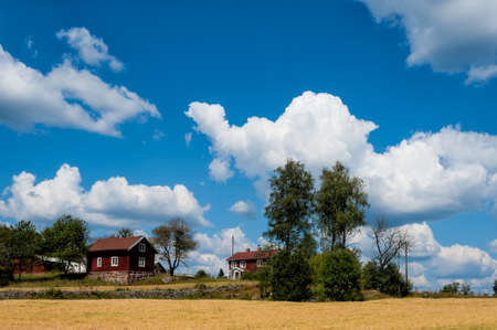 Farm in the country side of southern Sweden in the highlands of Småland near Ingatorp photo