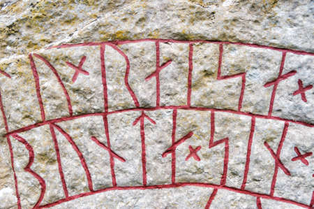 Detail of the rune stone from Bj?rby on the island of ?land, Sweden. The stone dates from the 11th century. Can be used as background or as a decoration photo