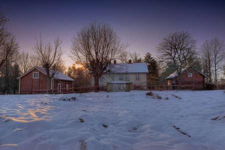 Abandoned farm near H?GSBY, Kalmar County, on a freezing winter evening photo