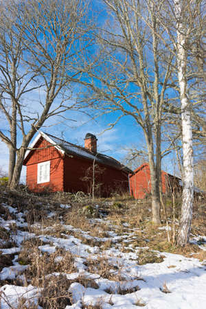 old barn in winter: Old red wooden cottage and barn in winter, Sweden.