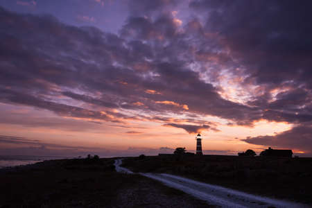 The lighthouse of Naersholmen on the island Gotland, Sweden, at sunset