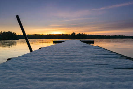 Jetty at a frozen lake in Sweden in winter Stock Photo
