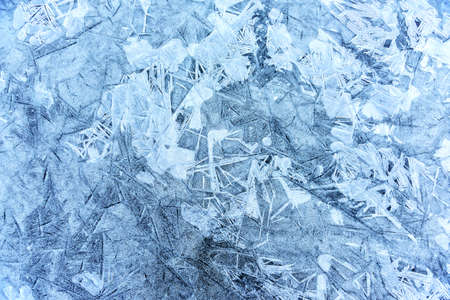 Structures in the ice of an frozen lake in winter. Usable as backgound or texture.