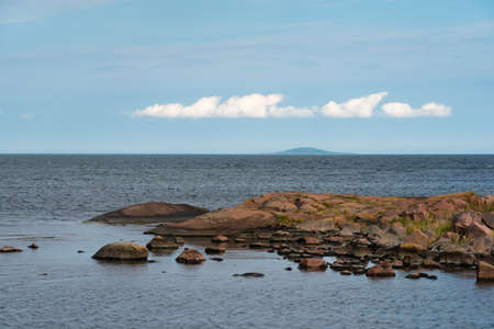 Swedish east coast with smooth polished granite rocks. In the background the famous Blue Virgin Island
