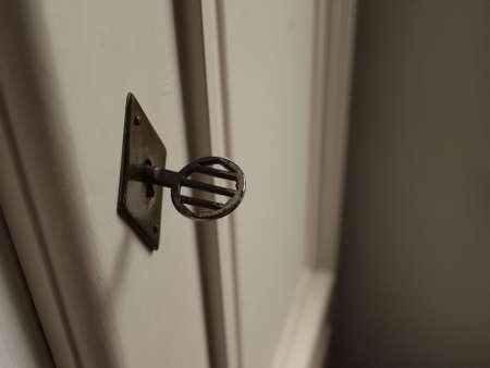 Old key in a door lock Stock Photo - 7844565