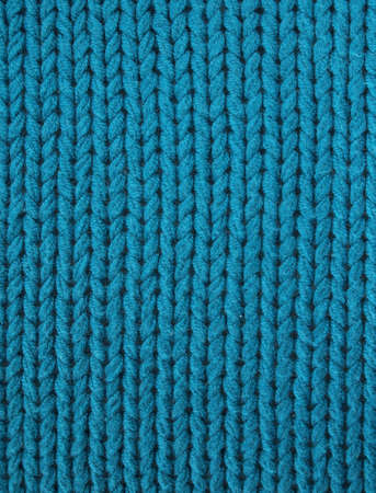 Knitted fabric in electric turquoise blue photo