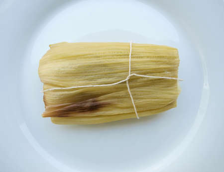 Sweet tamale, a traditional Latin American corn wrap photo