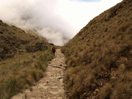 Tourist descending the Inca trail route  photo