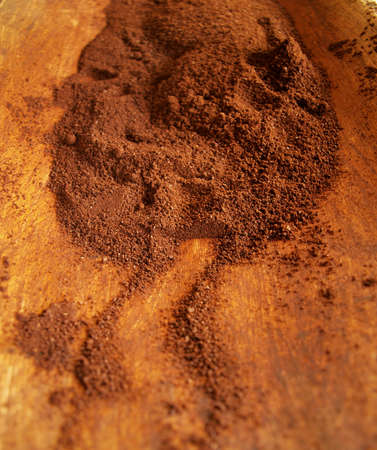 Coffee powder on wooden tray photo