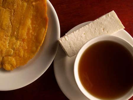 panela: Traditional colombia snack panela cheese and plantane Stock Photo