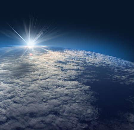 lizenzfreie fotos: Erde aus dem Weltraum mit Sonnenaufgang aus gesehen