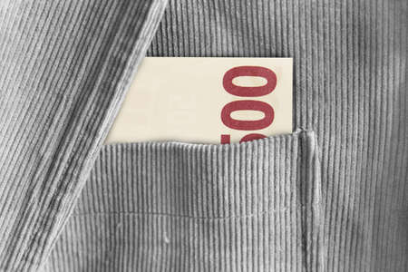 decadence: 500 Euro Banknotes in a jacket pocket Stock Photo