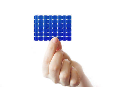 voltaic:           Solar cell in a hand on white