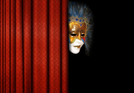mask behind theater curtains