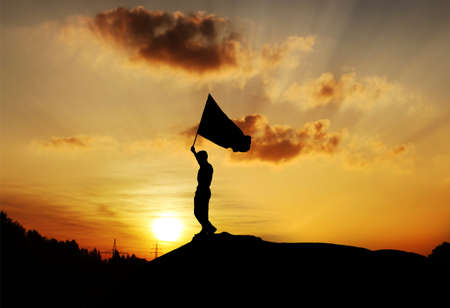 veterans: Man holding Flag in Sunset