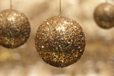 Gold glitter Christmas bauble ball photo